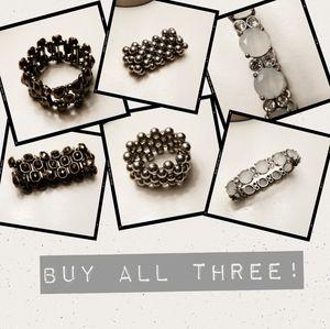 Three costume jewelry bracelets